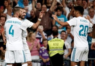 MADRID, SPAIN - AUGUST 16: Karim Benzema (2nd L) of Real Madrid celebrates with his teammates Sergio Ramos (4) and Marco Asensio (20) after scoring during the Spanish Super Cup return match between Real Madrid and Barcelona at Santiago Bernabeu Stadium in Madrid, Spain on August 16, 2017. Burak Akbulut / Anadolu Agency