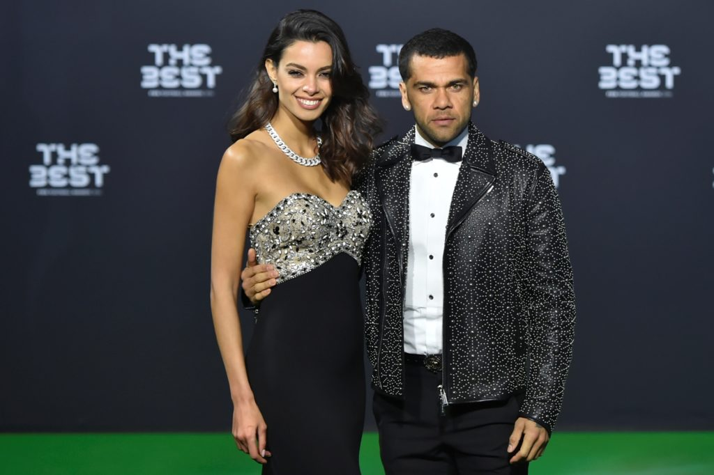 Juventus FC and Brazil's defender Dani Alves (R) and his partner Joana Sanz pose as they arrive for The Best FIFA Football Awards 2016 ceremony, on January 9, 2017 in Zurich. / AFP PHOTO / MICHAEL BUHOLZER