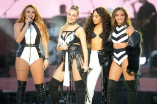 """In this photograph released by One Love Manchester on June 4, 2017, Jesy Nelson, Perrie Edwards, Leigh-Anne Pinnock and Jade Thirlwall of Little Mix perform at the One Love Manchester benefit concert for the families of the victims of the May 22, Manchester terror attack, at Emirates Old Trafford in Greater Manchester on June 4, 2017.  / AFP PHOTO / One Love Manchester / Dave Hogan for One Love Manchester / RESTRICTED TO EDITORIAL USE - MANDATORY CREDIT """"AFP PHOTO / ONE LOVE MANCHESTER / DAVE HOGAN"""" - NO MARKETING NO ADVERTISING CAMPAIGNS - DISTRIBUTED AS A SERVICE TO CLIENTS"""