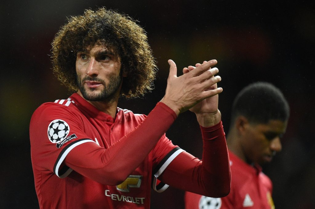 Manchester United's Belgian midfielder Marouane Fellaini applauds the fans following the UEFA Champions League Group A football match between Manchester United and Basel at Old Trafford in Manchester, north west England on September 12, 2017. Manchester United won 3-0.  / AFP PHOTO / Oli SCARFF