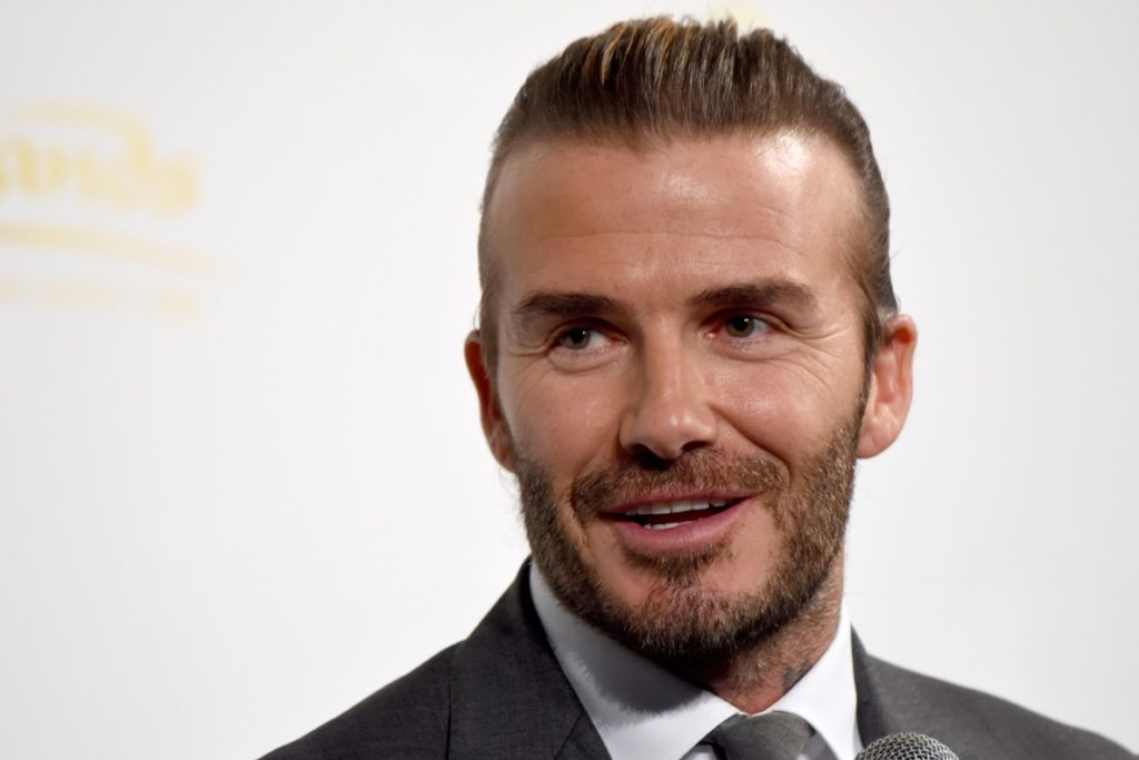 Former football player David Beckham answers questions during a promotional casino event in Tokyo on October 4, 2017.  / AFP PHOTO / Toru YAMANAKA