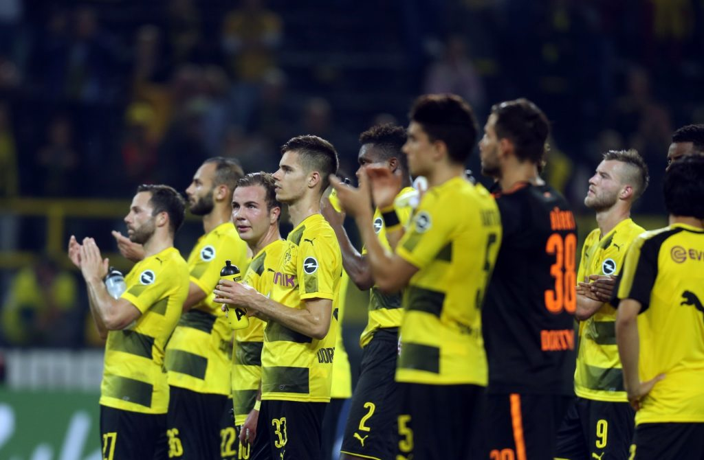 Dortmund players standing in front of the fans in the tribunes after Dortmund's defeat 3:2 defeat at the hands ofLeipzig at the German Bundesliga soccer match between Borussia Dortmund and RB Leipzig at the Signal Iduna Park in Dortmund, Germany, 14 October 2017.  (EMBARGO CONDITIONS - ATTENTION: Due to the accreditation guidelines, the DFL only permits the publication and utilisation of up to 15 pictures per match on the internet and in online media during the match.) Photo: Ina Fassbender/dpa