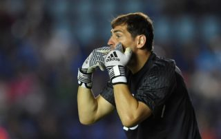"""Portugal's FC Porto goalkeeper Iker Casillas gestures during a """"Super Copa Tecate"""" tournament pre-season football match against Mexico's Cruz Azul at the Azul stadium in Mexico City on July 17, 2017. / AFP PHOTO / YURI CORTEZ"""