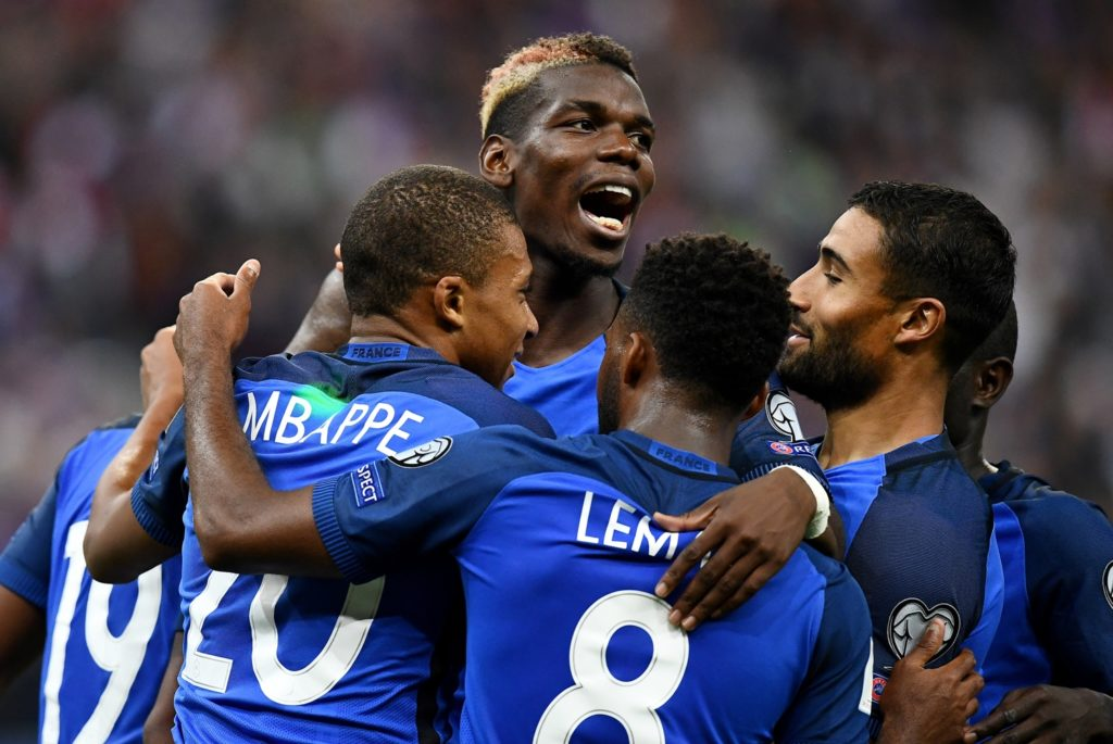 France's forward Kylian Mbappe (1st-L) celebrates after scoring a goal with his teammates during the 2018 FIFA World Cup qualifying football match France vs Netherlands at the Stade de France in Saint-Denis, north of Paris, on August 31, 2017. / AFP PHOTO / FRANCK FIFE