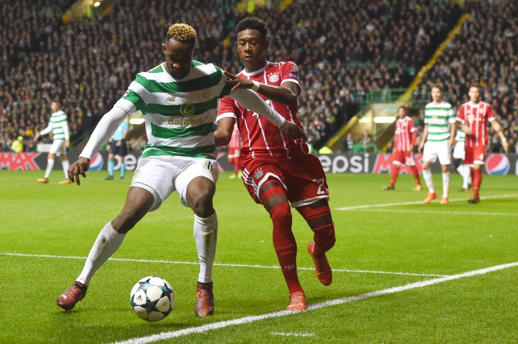 Celtic's French striker Moussa Dembele (L) vies with Bayern Munich's Austrian defender David Alaba during the UEFA Champions League Group B football match between Celtic and Bayern Munich at Celtic Park in Glasgow, on October 31, 2017. / AFP PHOTO / PAUL ELLIS