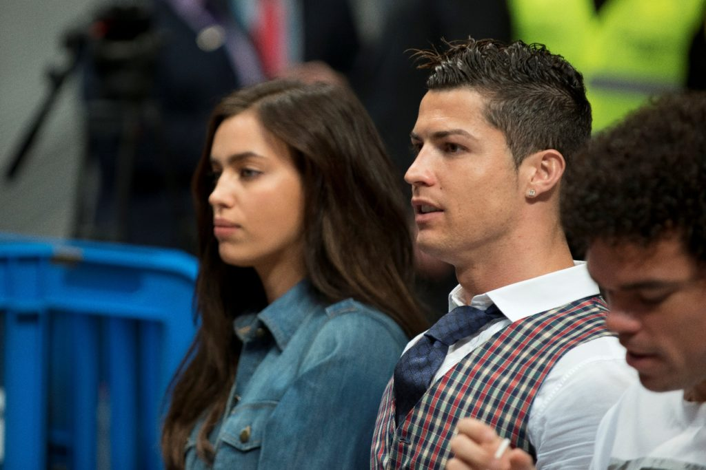 Real Madrid's Portuguese striker Cristiano Ronaldo  and his girlfriend, Russan model Irina Shayk  watch the Basketball Euroleague TOP 16 match between Real Madrid and CSKA Moscow played at Palacio de Deportes in Madrid, Spain, 20 March 2014.