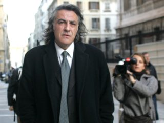 Former France international Jean-Francois Larios arrives 12 January 2007 at Marseille's courthouse, southern France. Jean-Francois Larios was today facing two-year suspended prison sentence for his alleged involvement as an agent in the Marseille transfers scandal. Between 1997 and 1999, nearly 28 million euros went illegally into the pockets of players, intermediaries and former coach Rolland Courbis who was given a three-and-a-half year prison sentence of which 18 months was suspended. AFP PHOTO / MICHEL GANGNE / AFP PHOTO / MICHEL GANGNE