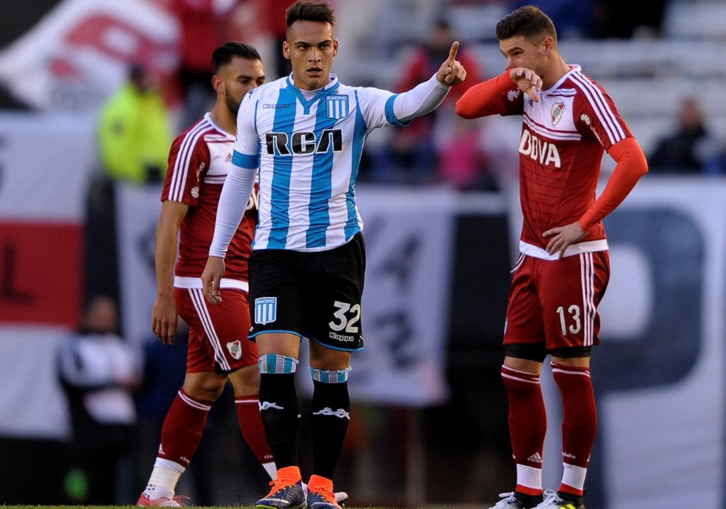 Racing's forward Lautaro Martinez (C) celebrates after scoring against River Plate during their Argentina First Division football match at the Antonio Vespucio Liberti stadium in Buenos Aires, on June 18, 2017. / AFP PHOTO / Alejandro PAGNI