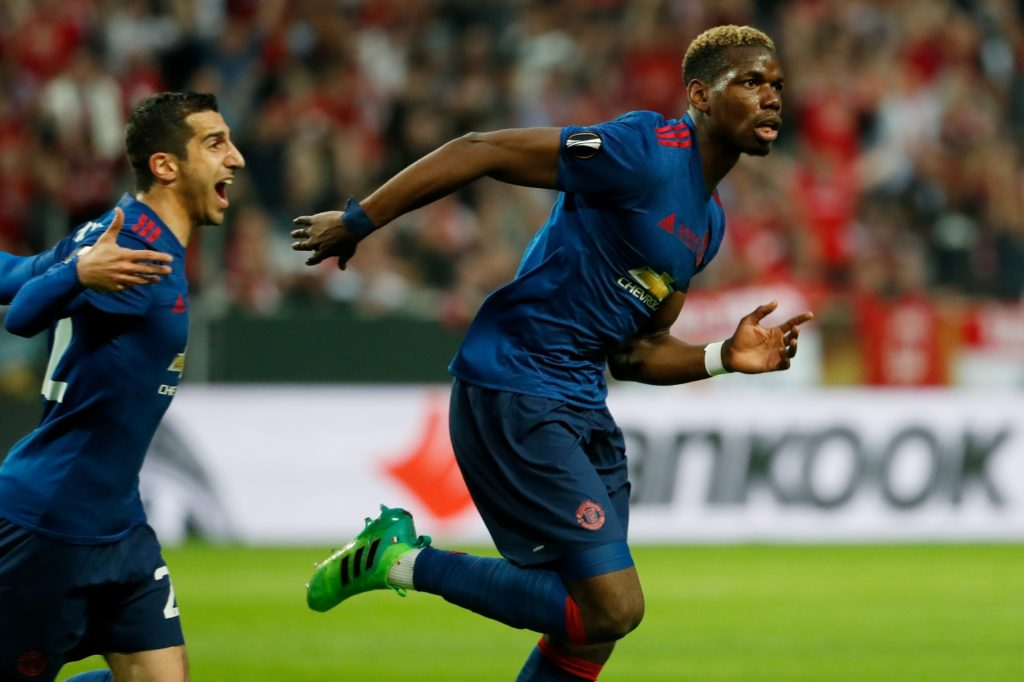Manchester United's French midfielder Paul Pogba celebrates scoring the opening goal with Armenian midfielder Henrikh Mkhitaryan (L) during the UEFA Europa League final football match Ajax Amsterdam v Manchester United on May 24, 2017 at the Friends Arena in Solna outside Stockholm. / AFP PHOTO / Odd ANDERSEN