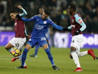 Leicester City's Algerian midfielder Riyad Mahrez (C) vies with West Ham United's Argentinian midfielder Manuel Lanzini (L) and West Ham United's Spanish midfielder Pedro Obiang during the English Premier League football match between West Ham United and Leicester City at The London Stadium, in east London on November 24, 2017. / AFP PHOTO / Ian KINGTON / RESTRICTED TO EDITORIAL USE. No use with unauthorized audio, video, data, fixture lists, club/league logos or 'live' services. Online in-match use limited to 75 images, no video emulation. No use in betting, games or single club/league/player publications.  /