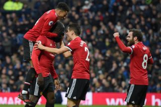 Manchester United's Belgian striker Romelu Lukaku (2nd L) celebrates with teammates after scoring the opening goal of the English Premier League football match between West Bromwich Albion and Manchester United at The Hawthorns stadium in West Bromwich, central England, on December 17, 2017.  / AFP PHOTO / Oli SCARFF / RESTRICTED TO EDITORIAL USE. No use with unauthorized audio, video, data, fixture lists, club/league logos or 'live' services. Online in-match use limited to 75 images, no video emulation. No use in betting, games or single club/league/player publications.  /
