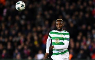 Celtic's French forward Moussa Dembele eyes the ball during the UEFA Champions League Group B football match between Paris Saint-Germain (PSG) and Glasgow Celtic at Parc des Princes Stadium in Paris on November 22, 2017.    / AFP PHOTO / FRANCK FIFE
