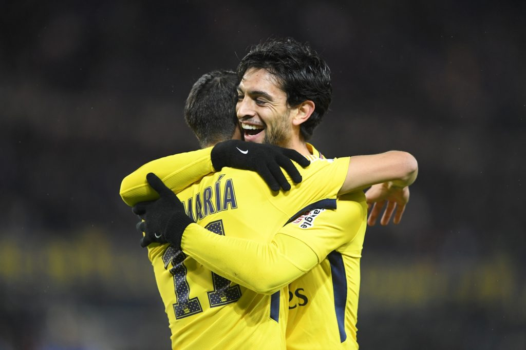 Paris Saint-Germain's Argentinian forward Angel Di Maria (L) is congratulated by Paris Saint-Germain's Argentinian forward Javier Pastore after scoring a goal during the French League Cup round of 16 football match between Strasbourg (RCSA) and Paris-Saint-Germain (PSG) on December 13, 2017 at the Meinau stadium in Strasbourg, eastern France. / AFP PHOTO / PATRICK HERTZOG