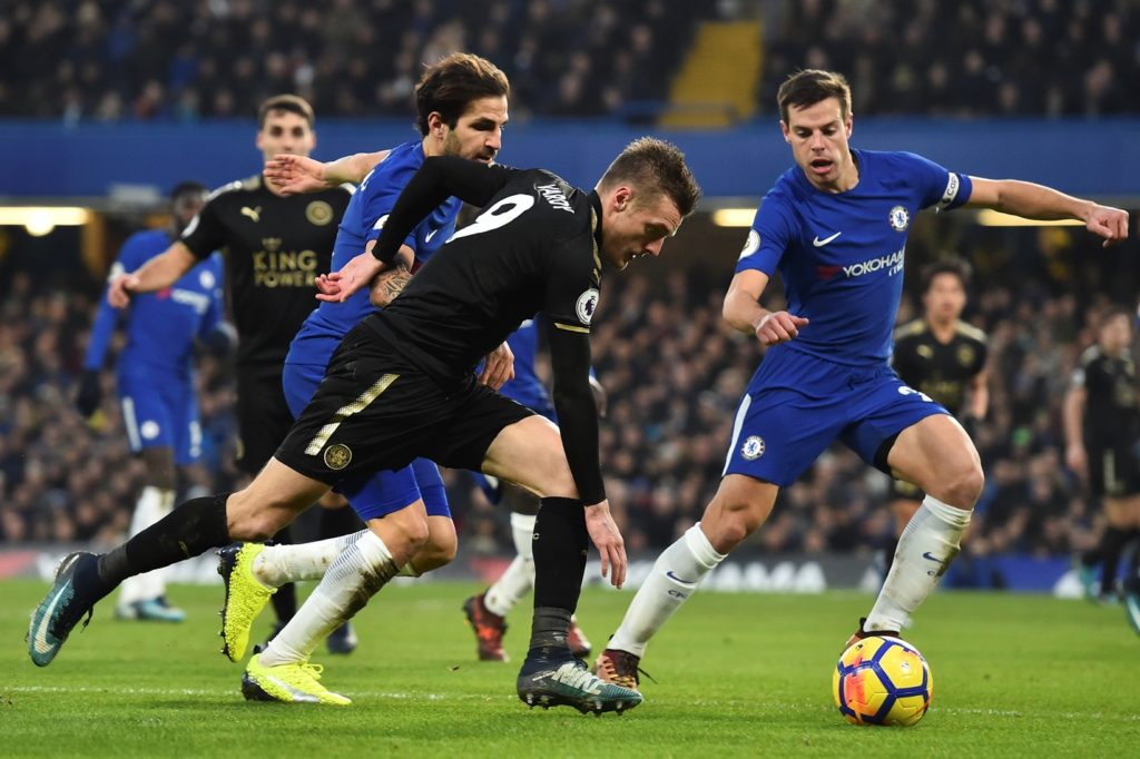 Leicester City's English striker Jamie Vardy (C) takes on Chelsea's Spanish midfielder Cesc Fabregas (L) an Chelsea's Spanish defender Cesar Azpilicueta (R) during the English Premier League football match between Chelsea and Leicester City at Stamford Bridge in London on January 13, 2018. / AFP PHOTO / Glyn KIRK / RESTRICTED TO EDITORIAL USE. No use with unauthorized audio, video, data, fixture lists, club/league logos or 'live' services. Online in-match use limited to 75 images, no video emulation. No use in betting, games or single club/league/player publications.  /