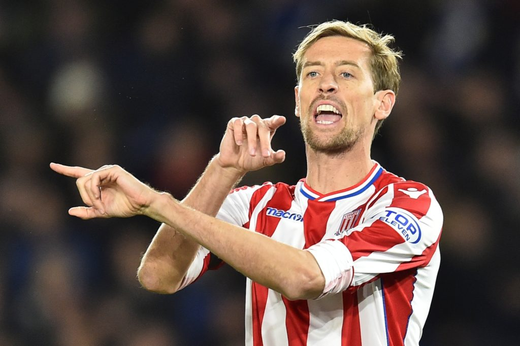 Stoke City's English striker Peter Crouch gives instructions to team-mates as he comes on as a substitute during the English Premier League football match between Brighton and Hove Albion and Stoke City at the American Express Community Stadium in Brighton, southern England on November 20, 2017. / AFP PHOTO / Glyn KIRK / RESTRICTED TO EDITORIAL USE. No use with unauthorized audio, video, data, fixture lists, club/league logos or 'live' services. Online in-match use limited to 75 images, no video emulation. No use in betting, games or single club/league/player publications.  /