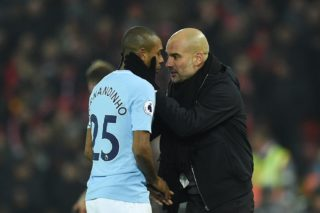 Manchester City's Spanish manager Pep Guardiola (R) talks with Manchester City's Brazilian midfielder Fernandinho (L) on the touchliner during the English Premier League football match between Liverpool and Manchester City at Anfield in Liverpool, north west England on January 14, 2018. / AFP PHOTO / Oli SCARFF / RESTRICTED TO EDITORIAL USE. No use with unauthorized audio, video, data, fixture lists, club/league logos or 'live' services. Online in-match use limited to 75 images, no video emulation. No use in betting, games or single club/league/player publications.  /