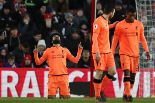 Liverpool's Egyptian midfielder Mohamed Salah celebrates scoring their second goal during the English Premier League football match between Southampton and Liverpool at St Mary's Stadium in Southampton, southern England on February 11, 2018. / AFP PHOTO / Adrian DENNIS / RESTRICTED TO EDITORIAL USE. No use with unauthorized audio, video, data, fixture lists, club/league logos or 'live' services. Online in-match use limited to 75 images, no video emulation. No use in betting, games or single club/league/player publications.  /