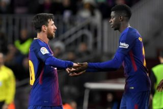 Barcelona's Argentinian forward Lionel Messi (L) is replaced by Barcelona's French forward Ousmane Dembele during the Spanish Copa del Rey (King's Cup) round of 16 second leg football match FC Barcelona vs RC Celta de Vigo at the Camp Nou stadium in Barcelona on January 11, 2018. / AFP PHOTO / LLUIS GENE