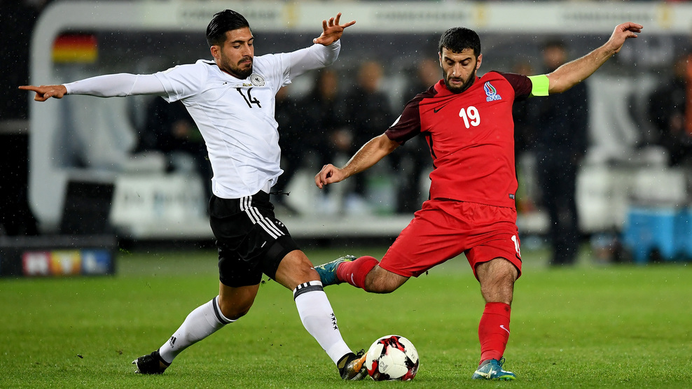 KAISERSLAUTERN, GERMANY - OCTOBER 08:  Emre Can (L) of Germany and Rahid Amirguliyev of Azerbaijan battle for the ball during the FIFA 2018 World Cup Qualifier between Germany and Azerbaijan at Fritz-Walter-Stadion on October 8, 2017 in Kaiserslautern, Rhineland-Palatinate.  (Photo by Matthias Hangst/Bongarts/Getty Images)