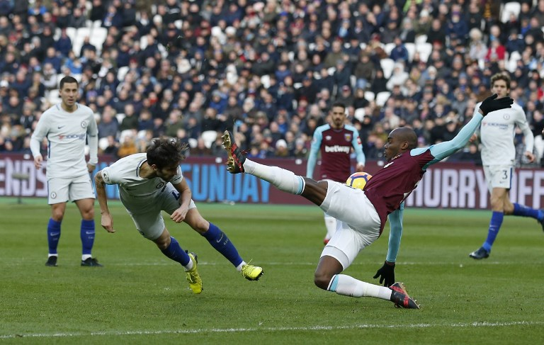 Chelsea's Spanish midfielder Cesc Fabregas (2nd L) attempts a header at goal during the English Premier League football match between West Ham United and Chelsea at The London Stadium, in east London on December 9, 2017. / AFP PHOTO / Ian KINGTON / RESTRICTED TO EDITORIAL USE. No use with unauthorized audio, video, data, fixture lists, club/league logos or 'live' services. Online in-match use limited to 75 images, no video emulation. No use in betting, games or single club/league/player publications.  /