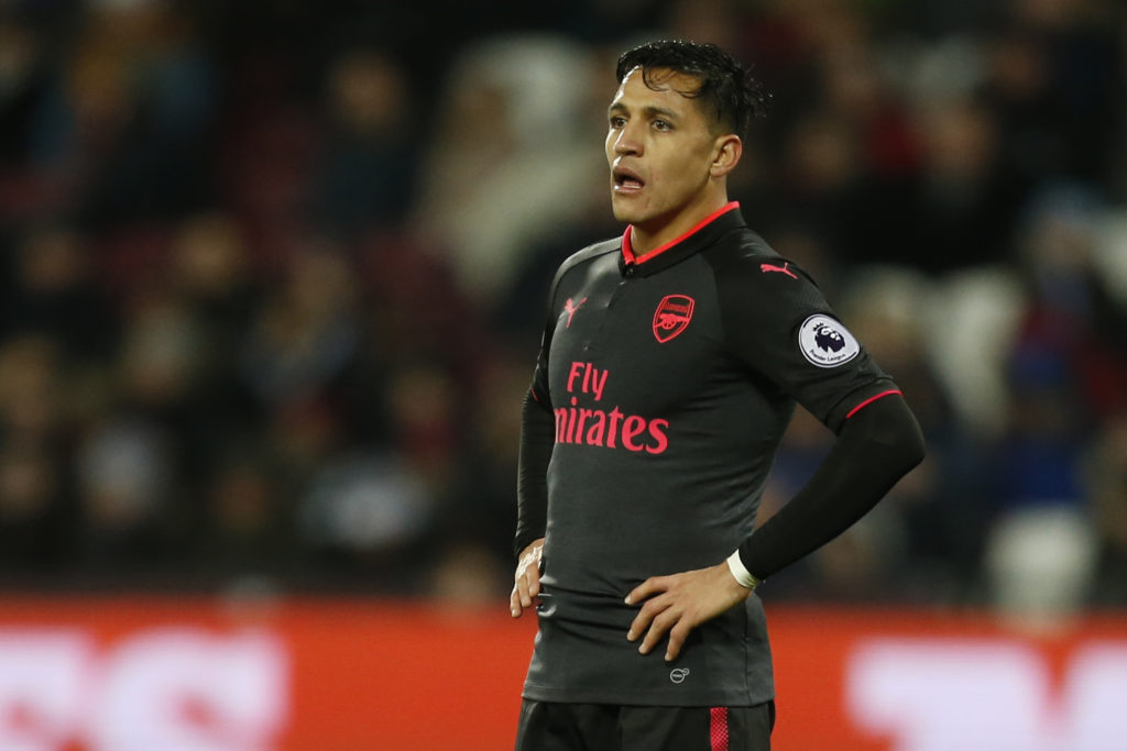 Arsenal's Chilean striker Alexis Sanchez looks on during the English Premier League football match between West Ham United and Arsenal at The London Stadium, in east London on December 13, 2017. / AFP PHOTO / Ian KINGTON / RESTRICTED TO EDITORIAL USE. No use with unauthorized audio, video, data, fixture lists, club/league logos or 'live' services. Online in-match use limited to 75 images, no video emulation. No use in betting, games or single club/league/player publications.  /