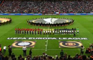 Players of Manchester United (R) and of Ajax Amsterdam stand on the pitch prior to the UEFA Europa League final football match Ajax Amsterdam v Manchester United on May 24, 2017 at the Friends Arena in Solna outside Stockholm. / AFP PHOTO / Janek SKARZYNSKI