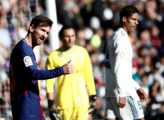 MADRID, SPAIN - DECEMBER 23: Lionel Messi (L) of Barcelona gestures during the La Liga match between Real Madrid and Barcelona at Santiago Bernabeu Stadium in Madrid, Spain on December 23, 2017. Burak Akbulut / Anadolu Agency