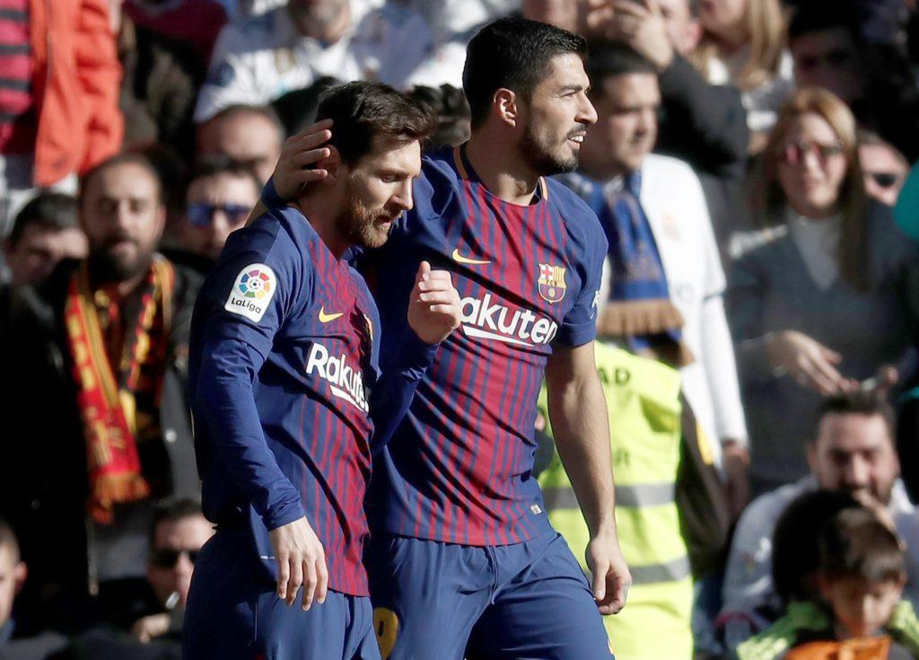 MADRID, SPAIN - DECEMBER 23: Luis Suarez (R) and Lionel Messi (L) of Barcelona celebrate after scoring a goal during the La Liga match between Real Madrid and Barcelona at Santiago Bernabeu Stadium in Madrid, Spain on December 23, 2017. Burak Akbulut / Anadolu Agency