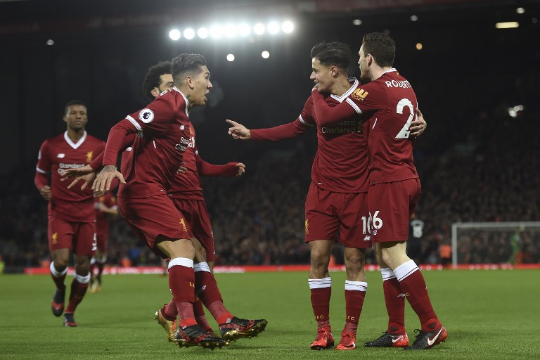 Liverpool's Brazilian midfielder Philippe Coutinho (2R) celebrates scoring the English Premier League football match between Liverpool and Swansea City at Anfield in Liverpool, north west England on December 26, 2017. / AFP PHOTO / PAUL ELLIS / RESTRICTED TO EDITORIAL USE. No use with unauthorized audio, video, data, fixture lists, club/league logos or 'live' services. Online in-match use limited to 75 images, no video emulation. No use in betting, games or single club/league/player publications.  /