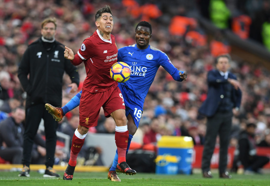 Liverpool's Brazilian midfielder Roberto Firmino (CL) vies with Leicester City's Ghanaian midfielder Daniel Amartey as Liverpool's German manager Jurgen Klopp (L) and Leicester City's French manager Claude Puel (R) look on during the English Premier League football match between Liverpool and Leicester at Anfield in Liverpool, north west England on December 30, 2017. / AFP PHOTO / Paul ELLIS / RESTRICTED TO EDITORIAL USE. No use with unauthorized audio, video, data, fixture lists, club/league logos or 'live' services. Online in-match use limited to 75 images, no video emulation. No use in betting, games or single club/league/player publications.  /