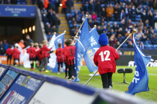 Young fans act as flag bearers during the English championship Premier League football match between Leicester City and Middlesbrough on November 26, 2016 played at the King Power Stadium in Leicester, England - Photo Philip Oldham / Backpage Images / DPPI