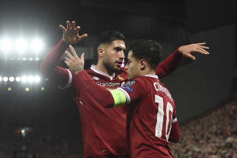 Liverpool's Brazilian midfielder Philippe Coutinho (R) is hugged by Liverpool's German midfielder Emre Can (L) after Coutinho scored their second goal during the UEFA Champions League Group E football match between Liverpool and Spartak Moscow at Anfield in Liverpool, north-west England on December 6, 2017. / AFP PHOTO / PAUL ELLIS