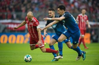 Arjen Robben of Munich and Hoffenheim's Benjamin Huebner (R) vie for the ball during the German Bundesliga football match between Bayern Munich and 1899 Hoffenheim at the Allianz Arena in Munich, Germany, 27January 2018.   (EMBARGO CONDITIONS - ATTENTION: Due to the accreditation guidelines, the DFL only permits the publication and utilisation of up to 15 pictures per match on the internet and in online media during the match.) Photo: Lino Mirgeler/dpa