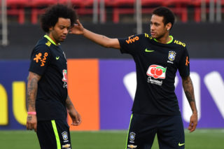 Brazil's team player Neymar (R) jokes with Marcelo (L) during a training session at the Morumbi stadium in Sao Paulo, Brazil on March 25, 2017 ahead of a 2018 FIFA World Cup qualifier match against Paraguay on March 28 in Sao Paulo, Brazil. / AFP PHOTO / NELSON ALMEIDA