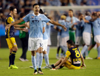 KANSAS CITY, KS - SEPTEMBER 20: Daniel Salloi #30 of Sporting Kansas City celebrates as Sporting defeats the New York Red Bulls 2-1 to win the 2017 U.S Open Cup Final at Children's Mercy Park on September 20, 2017 in Kansas City, Kansas.   Jamie Squire/Getty Images/AFP