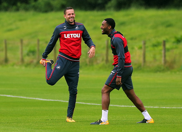 SWANSEA, WALES - JULY 11: (L-R) Gylfi Sigurdsson stretches with Leroy Fer during the Swansea City Training at The Fairwood Training Ground on July 11, 2017 in Swansea, Wales. (Photo by Athena Pictures/Getty Images)