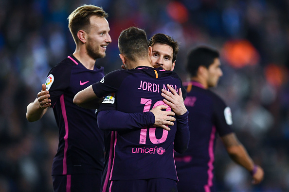 BARCELONA, SPAIN - APRIL 29:  Lionel Messi (C) of FC Barcelona celebrates with his team mate Jordi Alba after Ivan Rakitic of FC Barcelona (L) scored his team's second goal during the La Liga match between RCD Espanyol and FC Barcelona at the RCDE Stadium on April 29, 2017 in Barcelona, Spaain.  (Photo by David Ramos/Getty Images)