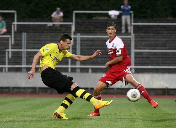 DORTMUND, GERMANY - AUGUST 09:  Maximilian Welzmueller (R) of Unterhaching and Balint Marcel Bajner (L) of Borussia Dortmund fight for the ball during the game between Borussia Dortmund II v SpVgg Unterhaching at 3. Liga on August 9, 2013 in Dortmund, Germany.  (Photo by Mathis Wienand/Bongarts/Getty Images)