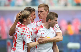 LEIPZIG, GERMANY - AUGUST 27: Timo Werner of Leipzig (R) of Leipzig celebrates after scoring his team's first goal with Emil Forsberg (L), Willi Orban (2nd L) and Marcel Halstenberg (3rd L) of Leipzig during the Bundesliga match between RB Leipzig and Sport-Club Freiburg at Red Bull Arena on August 27, 2017 in Leipzig, Germany. (Photo by Ronny Hartmann/Bongarts/Getty Images)