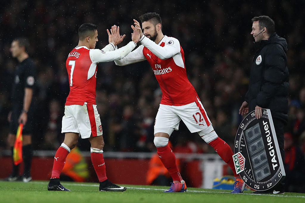 LONDON, ENGLAND - DECEMBER 10: Alexis Sanchez of Arsenal (L) comes off for Olivier Giroud of Arsenal (R) during the Premier League match between Arsenal and Stoke City at the Emirates Stadium on December 10, 2016 in London, England.  (Photo by Julian Finney/Getty Images)