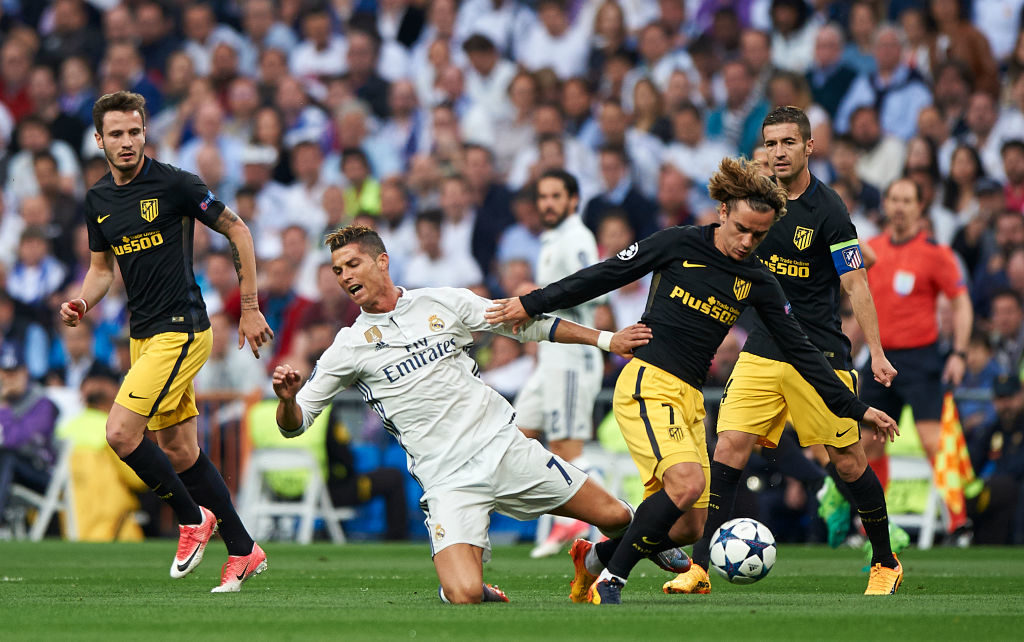 MADRID, SPAIN - MAY 02:  Cristiano Ronaldo (C) of Real Madrid is tackled by Antoine Griezmann (R) of Club Atletico de Madrid during the UEFA Champions League semi-final first leg match between Real Madrid CF and Club Atletico de Madrid at Estadio Santiago Bernabeu on May 2, 2017 in Madrid, Spain.  (Photo by fotopress/Getty Images)