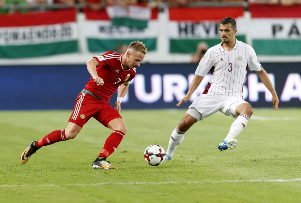 BUDAPEST, HUNGARY - AUGUST 31: Balazs Dzsudzsak (L) of Hungary competes for the ball with Nikita Kolesovs #3 of Latvia during the FIFA 2018 World Cup Qualifier match between Hungary and Latvia at Groupama Arena on August 31, 2017 in Budapest, Hungary. (Photo by Laszlo Szirtesi/Getty Images)