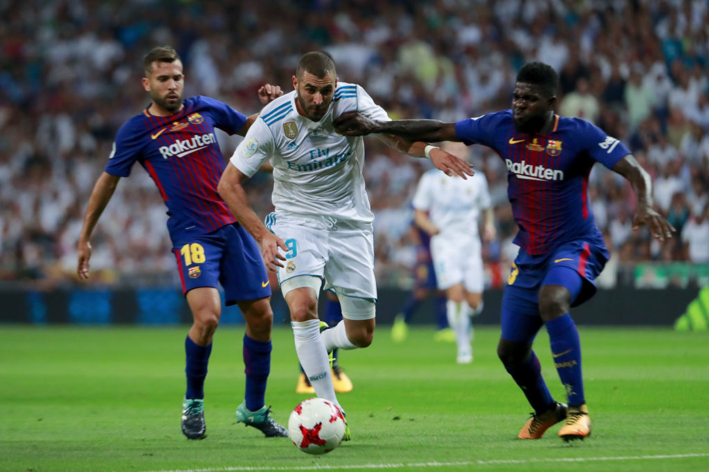 MADRID, SPAIN - AUGUST 16:  Karim Benzema (2ndL) of Real Madrid CF competes for the ball with Samuel Umiti (R) of FC Barcelona and his teammate Jordi Alba (L) during the Supercopa de Espana Final 2nd Leg match between Real Madrid and FC Barcelona at Estadio Santiago Bernabeu on August 16, 2017 in Madrid, Spain.  (Photo by Gonzalo Arroyo Moreno/Getty Images)