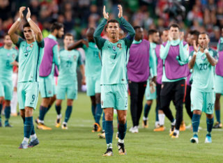 BUDAPEST, HUNGARY - SEPTEMBER 3: Cristiano Ronaldo #7 of Portugal celebrates and thanks for the support of the Portuguese fans with Andre Silva #9 of Portugal and Ricardo Quaresma #20 of Portugal after the FIFA 2018 World Cup Qualifier match between Hungary and Portugal at Groupama Arena on September 3, 2017 in Budapest, Hungary. (Photo by Laszlo Szirtesi/Getty Images)