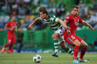 LISBON, PORTUGAL - AUGUST 15: Sporting CP midfielder Adrien Silva from Portugal with Steaua Bucuresti FC midfielder Mihai Pintilii from Romania in action during the UEFA Champions League Qualifying Play-Offs Round - First Leg match between Sporting Clube de Portugal and Steaua Bucuresti FC at Estadio Jose Alvalade on August 15, 2017 in Lisbon, Portugal.  (Photo by Gualter Fatia/Getty Images)