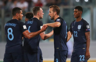 VALLETTA, MALTA - SEPTEMBER 01:  Harry Kane of England (2R) celebrates as he scores their first goal with Jake Livermore (8) during the FIFA 2018 World Cup Qualifier between Malta and England at Ta'Qali National Stadium on September 1, 2017 in Valletta, Malta.  (Photo by Julian Finney/Getty Images)
