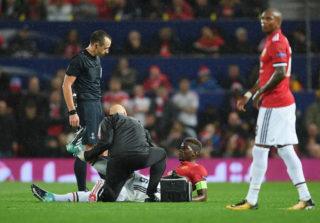 MANCHESTER, ENGLAND - SEPTEMBER 12: Paul Pogba of Manchester United receives treatment from the medical team during the UEFA Champions League Group A match between Manchester United and FC Basel at Old Trafford on September 12, 2017 in Manchester, United Kingdom.  (Photo by Laurence Griffiths/Getty Images)