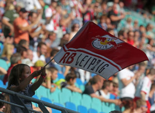 LEIPZIG, GERMANY - JUNE 27:  A supporter of Leipzig with a flag is pictured during the B Juniors Bundesliga final match between RB Leipzig and Borussia Dortmund at Red Bull Arena on June 27, 2014 in Leipzig, Germany. (Photo by Matthias Kern/Bongarts/Getty Images)