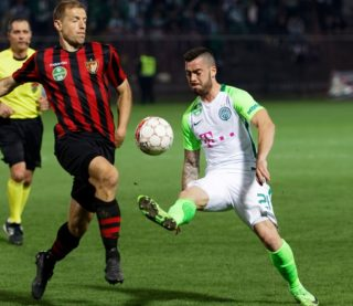 BUDAPEST, HUNGARY - APRIL 1: Djordje Kamber (L) of Budapest Honved duels for the ball with Endre Botka #21 of Ferencvarosi TC during the Hungarian OTP Bank Liga match between Budapest Honved and Ferencvarosi TC at Bozsik Stadium on April 1, 2017 in Budapest, Hungary. (Photo by Laszlo Szirtesi/Getty Images)