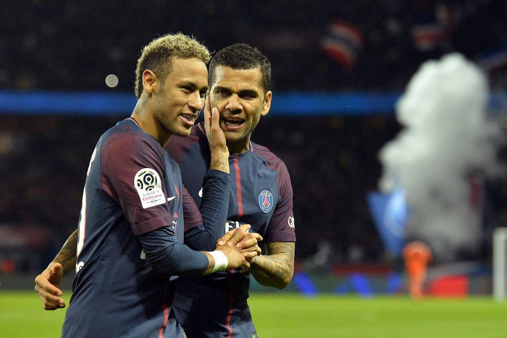 PARIS, FRANCE - SEPTEMBER 17:  Neymar Jr and Dani Alves of Paris Saint-Germain react after Kylian Mbappe scored during the Ligue 1 match between Paris Saint Germain and Olympique Lyonnais  at Parc des Princes on September 17, 2017 in Paris, .  (Photo by Aurelien Meunier/Getty Images)